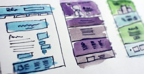 pen and paper wireframes, coloured in