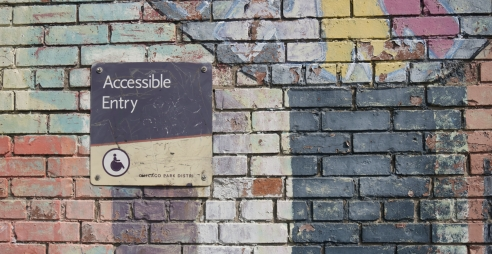 Accessibility Sign on Wall