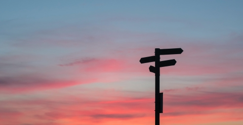 Signposts at sunset