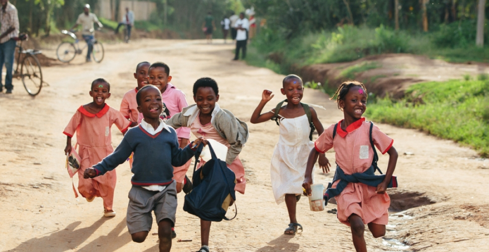Happy school children running - photo of those Bóthar is helping