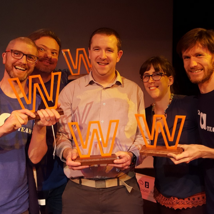 Annertech staff holding multiple awards, including Web Agency of the Year